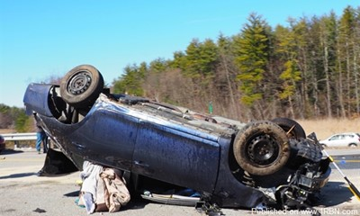 Rollover in Bedford Sends One to Hospital