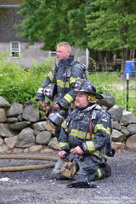 Firefighters taking a break during a structure fire